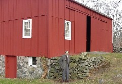 Bob Muller standing in front of the barn.  Click for a higher          resolution picture